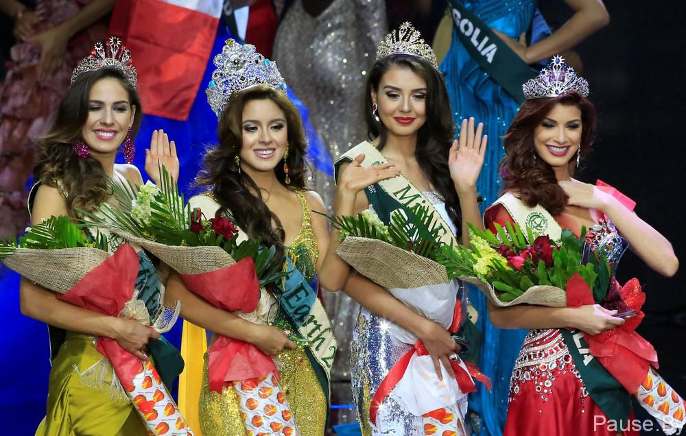 Miss Ecuador Katherine Espin (2nd L), crowned this year's Miss Earth, Miss Colombia Michelle Gomez (2nd R), won as Miss Earth Air, Miss Brazil Bruna Zanardo (L), as Miss Earth Fire and Miss Venezuela Stephanie De Zorzi, won as Miss Earth Water, wave to photographers during the Miss Earth 2016 International coronation night at a mall in Pasay city, metro Manila, Philippines October 29, 2016. REUTERS/Romeo Ranoco